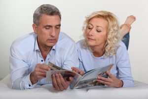 Couple looking at house plans and standard features