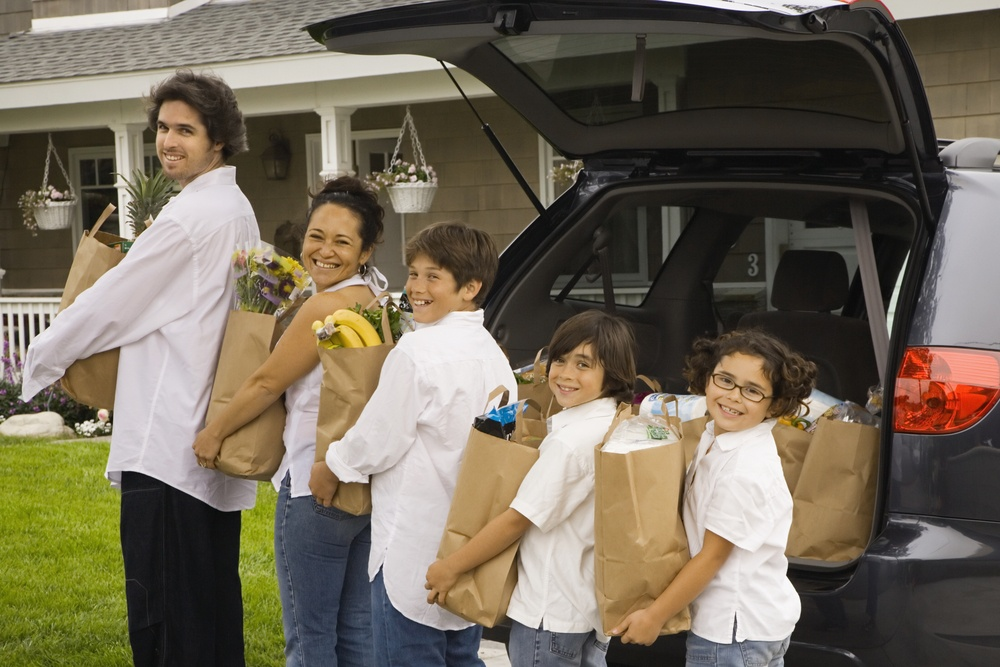 family unloading groceries