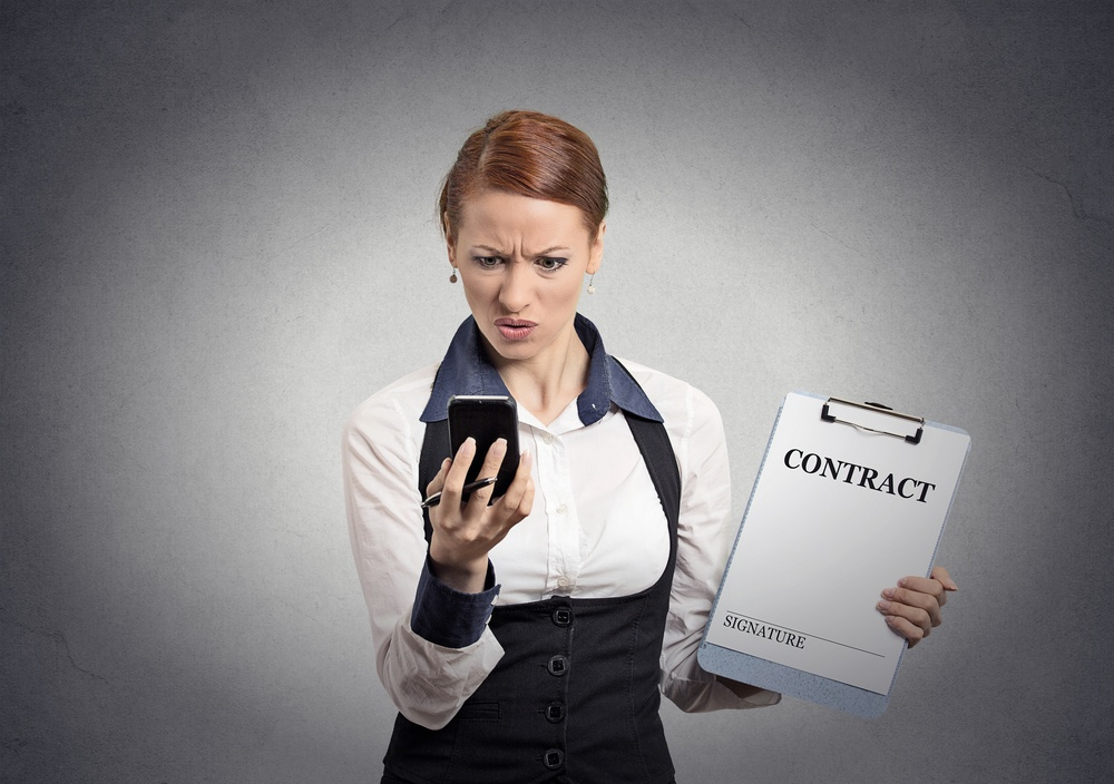 skeptical woman with contract